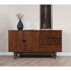 Perfect for your dining or entertaining rooms, this Tessuto buffet features integrated pulls and a unique off-set inlay that marks it with high style. The durable rubberwood construction is finished in a beautiful oak.