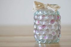Easy mason jar crafts idea for DIY mason jar lights. Dollar store idea uses glass stones to make a cool, creative DIY project - the mason jar prism light.
