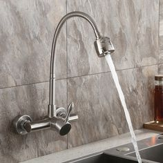 Brushed Nickel Wall Mount Stainless Steel Kitchen Faucet with Dual Function Sprayer Wall Mount Kitchen Faucet, Stainless Steel Kitchen Faucet, Kitchen Faucet With Sprayer, Wall Mount Faucet, Tiny House Design, Brushed Nickel, New Homes, Cleaning, Clean Lines