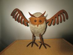 owl made of granite and steel