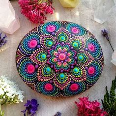 The biggest and most colourful mandala stone I've ever created! The biggest and most colourful mandala stone I've ever created! Rock Painting Patterns, Dot Art Painting, Rock Painting Designs, Stone Painting, Mandala Painted Rocks, Mandala Rocks, Hand Painted Rocks, Stone Crafts, Rock Crafts