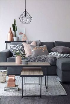 Can't go for those rose gold tones (we've got silver everywhere in the house), but like the textures, soft tones next to grey. The accessories (cactus, vase). Great coffee table.