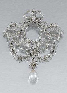 PEARL AND DIAMOND BROOCH/PENDANT, CIRCA 1905.  In the garland style, designed as a tied ribbon bow with scrolls and articulated floral swags, culminating in a pearl drop, millegrain-set with circular- and single-cut diamonds, drop detachable, two small stones deficient, fitted case.