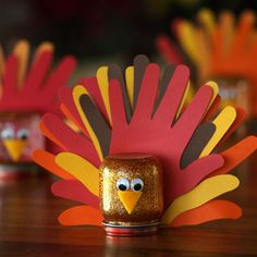 Little turkeys made with a recycled baby food jar and hand prints. Super cute! #crafts #thanksgiving