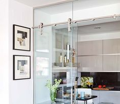 sliding glass door separates tiny kitchen via Mi Casa Revista