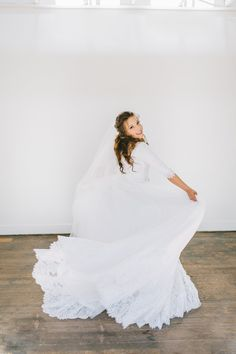 modest wedding dress with elbow sleeves and a full skirt from alta moda. -- (modest bridal gown)