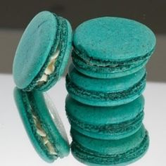 macarons...mmm! with white or milk chocolate and metallic dusting would be so pretty for favors! by fifi luis