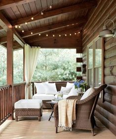 Light and Airy: String lights from Target twinkle over the front porch of this Ohio lake house, and Pottery Barn wicker furniture surrounds an antique folding table, where the family plays cards. Click through for more porches and patios we love. Outdoor Spaces, Outdoor Living, Outdoor Decor, Outdoor Seating, Outdoor Patios, Outdoor Kitchens, Extra Seating, Outdoor Ideas, Building A Porch