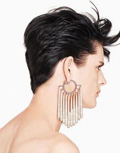 Stella Tennant models Joel Arthur Rosenthal's handmade pieces. Striped chalcedony and diamond fringe earrings.