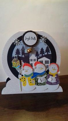 Craftwork cards snowglobe and Tattered Lace snowmen dies.