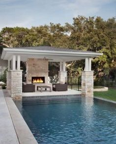 Outdoor fireplace with patio cover