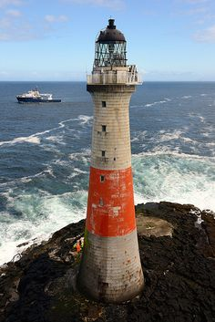 Dubh Artach Lighthouse and the NLB ship Pharos 18 miles west of Colonsay, Scotland