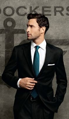 Simple black suit with a pop of turquoise in the form of a tie (Noah Mills for Dockers)