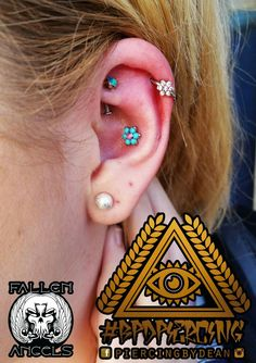 Anatometal Flower in Conch. Flower Helix and Peacock Opal Rook