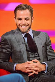 Chris Pine. He has a great smile...and boy can he wear a suit...