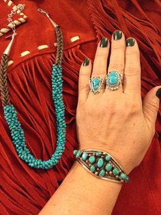 Santo Domingo Sleeping Beauty Turquoise necklace by Beatriz Garcia at High Desert Turquoise. Cluster turquoise cuff from Payne Auction of Cheyenne. Turquoise rings both from Dicks Rock Shop, Fountain, CO.