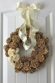 My newest wreath! Gold pinecone wreath with wooden balsa flowers by Jennyk5536, $19.99