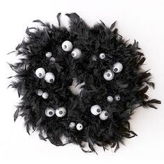 Got an old feather boa in your Halloween bag? Use it to make a cool wreath for your door!