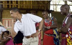 Barack Obama jokingly poses for his family wearing a new belt that he bought while on safari at Masai Mara, Kenya