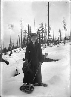 Mattie Gunterman with a rifle and holding a grouse VPL Accession Number: 2215 Date: 190- Photographer/Studio: Gunterman, Ida Madeline Warner (Mattie) Content: Note on glass negative envelope credited to F. Lade.'Madeline (Mattie) Gunterman wearing snow shoes'. Circa 1907 - from 'Flapjacks and Photographs' by Henri Robideau 1995 p. 136 http://www3.vpl.ca/spe/histphotos/