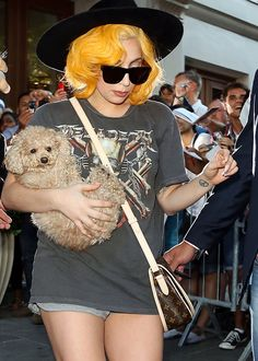 Lady G carrying Fozzi Bear