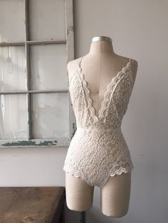 Whether youre a heartbreaker or not be prepared for some heart thumping! The Bride to Be Ivory Lace Lingerie Teddy is made to stir things up. This