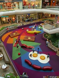 Indoor play area at Cherry Creek Mall in Denver, CO. But don't jump in your car to head down to this breakfast-themed play area, as it appears to have been replaced by a Looney Tunes theme :( Playground Design, Indoor Playground, Play Spaces, Kid Spaces, Atelier Architecture, Cool Playgrounds, Indoor Play Areas, Shopping Malls, Shopping Sites
