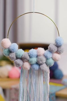 This simply beautiful pom pom dream catcher is ideal for adding a soft, dreamy finish to bedrooms and nurseries. Learn how to make your own with our step-by-step tutorial. Make Your Own, Make It Yourself, Create And Craft, Nurseries, Simply Beautiful, Easy Crafts, Nursery Decor, Dream Catcher, Diy Home Decor