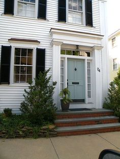 I love this simple front door area on a navy colonial with white details