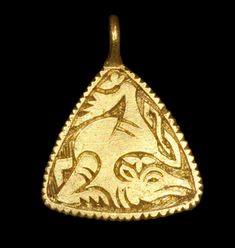 Anglo-Saxon Gold Beast Pendant, 9th Century AD A triangular gold pendant with slightly convex edges and integral cast loop; the outer edges notched; the central keyed field with reserved beast in Trewhiddle Style with returned twisted tail; trefoil motifs above the head and the four-toed foot, the foreleg folded beneath the chest.