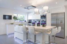 Clean Design, White with dining island. #Kitchen #DiningRoom #CleanDesign #White #PurpleFlowers #KitchenIsland #Braverman
