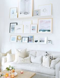 Open shelving in your living room will make swapping out seasonal pieces on your gallery wall a total cinch.