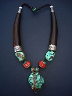 'Embrace' Huge turquoise nugget pendant embedded with brass and turquoise is surrounded by 2 similar smaller turquoise beads and two coral beads embedded with brass & turquoise. Two large curved yak horn cones with repoussee si I Love Jewelry, Tribal Jewelry, Turquoise Jewelry, Statement Jewelry, Stone Jewelry, Jewelry Art, Beaded Jewelry, Jewelry Accessories, Jewelry Necklaces