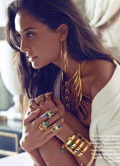 Lisa Haydon rocking contemporary gold jewelry. love the rings, statement necklace, earrings and cuffs