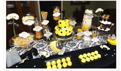 Black and yellow party decor! The candy jars are a great idea!