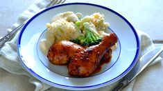 Spicy roasted drumsticks with cheesy cauliflower and broccoli bake