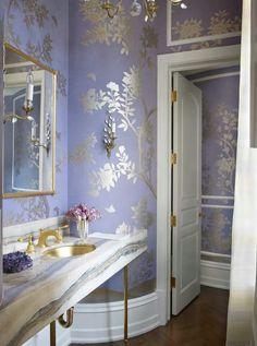 Elegant powder room in lavender silk and brass.