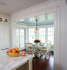 This would be on my (pretty unrealistic) wish list:  add on a small dining area surrounded by windows, allowing room for MUCh larger kitchen.
