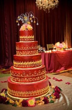 The delicately decorated cake was topped with crystals. The sweetheart table in the background had an intimate feel in the large ballroom.