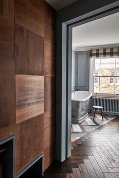 Deeply rooted in its surrounding area, The Lost Poet comes from the team at Cubic Studios – a local property design studio, born and bred in Notting Hill. The townhouse is a poetic love letter to the area, celebrating its creativity and dynamism through four individually designed bedrooms. Guests will find modern art, bold wallpapers and bespoke furniture sitting in juxtaposition with antique trinkets and reclaimed wood panelling created from old school science labs. Wood Paneling, Panelling, Bold Wallpaper, Property Design, Bespoke Furniture, Townhouse, Old School, Science Labs, Notting Hill