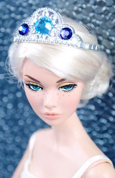 This tiara is fit for a stunning queen. In silver plastic with ornate details and topped with two tones of Swarovski crystals!!
