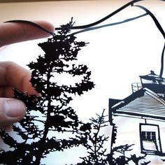 This is cool!   Papercut Maine Landscape - Bass Harbor - Framed Hand-Cut Paper Art.  via Etsy.