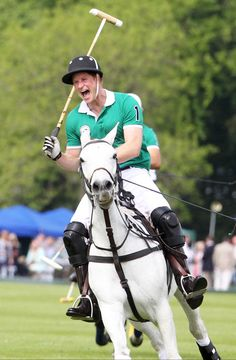 Prince Harry competes for the Jerudong Trophy during a charity polo match at Cirencester Park Polo Club in Cirencester Park, England, on May 24, 2015.