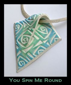 Polymer Clay Pendant -- I don't necessarily care for the square spiral design and/or color scheme of this pendant.  But I do really like how the overlapping built in bail disappears into the base design.