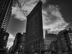 The iconic Flatiron Building stands like a monolith between Broadway and 5th Ave. in Midtown Manhattan, NYC.