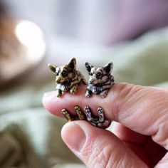 - A charming animal ring made in the shape of a Welsh Corgi Puppy! - It's very detailed and it looks like the Welsh Corgi Puppy has its paws wrapped around your finger! - One size fits all and is plat
