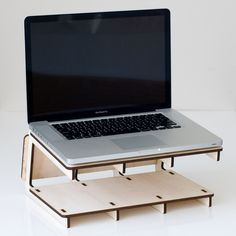 In my opinion, this laptop stand is very convenient and useful because you can place your other paper work under the desk so you can pull out books or work when you need it. This also keeps you organized and saves a lot of space on your desk. The down side to this product is that it can only be used on a flat surface because it has no legs.