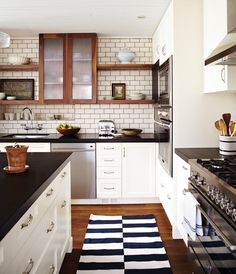 10 Kitchens We Can't Stop Pinning! - 10 Kitchens We Can't Stop Pinning! In this kitchen, walnut open shelving, glass-fronted cabinets and subway tile with dark grout lends the room a bistro-inspired feel. Bistro Kitchen, Farmhouse Kitchen Decor, New Kitchen, Kitchen Ideas, Kitchen Carts, Farmhouse Sinks, Farmhouse Table, Vintage Kitchen, Modern Farmhouse