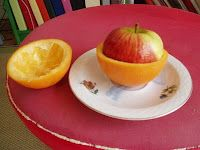 April Fool's apple. - Put an apple inside the victims hollowed out grapefruit halves.  They'll be surprised .