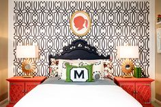 Tween Spaces - contemporary with graphic wallpaper and coral accents. The black headboard adds to the symmetry of the two bed side tables w table lamps.